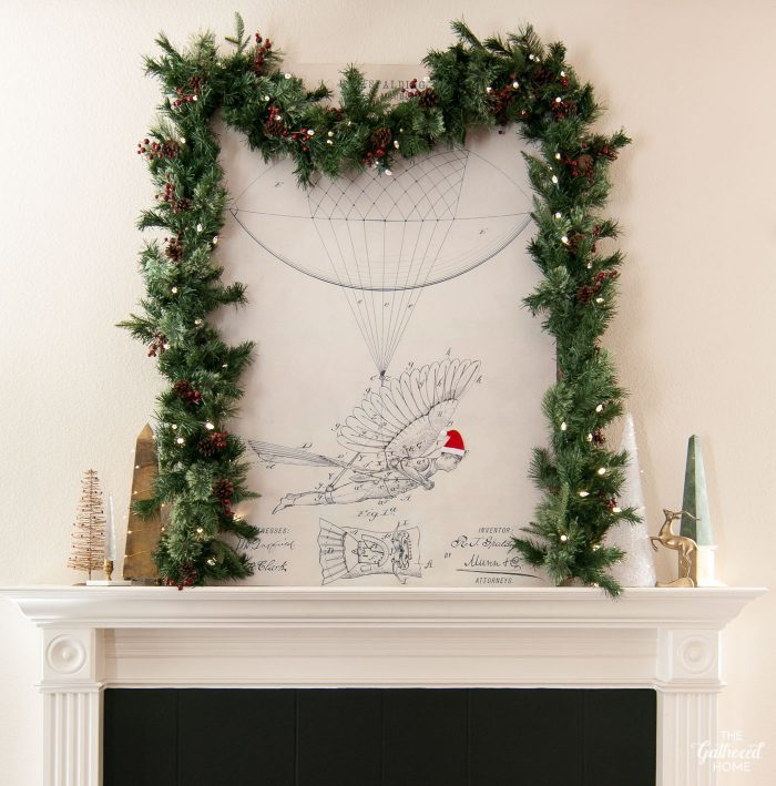 The mantel just gets a few holiday updates - prelit garland, some vintage Christmas trees, a brass gazelle, and fairy lights!