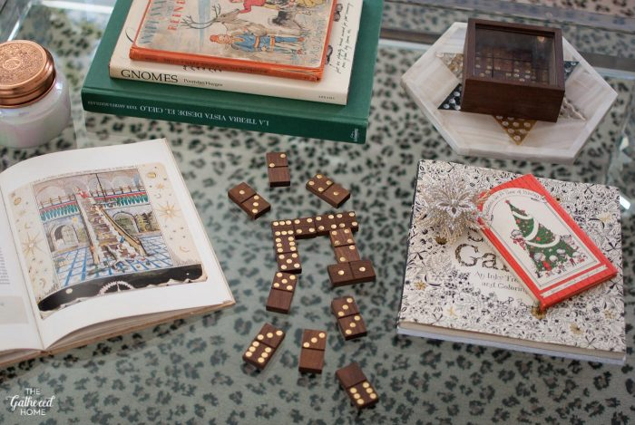 Christmas coffee table styling: vintage Christmas books, coloring books, and games are ready for guests!