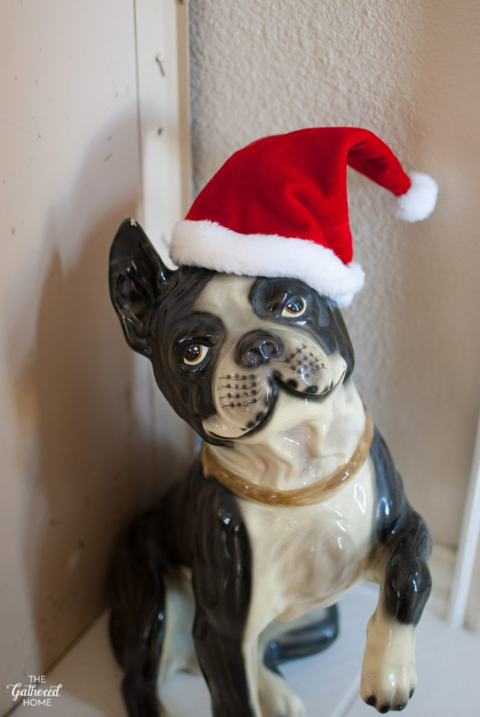 "Our life-sized Boston Terrier statue, ""Baxter"", greets guests with a jaunty Santa hat"