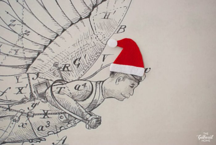 Add a jolly little Santa hat (made from felt scraps) to your existing artwork!