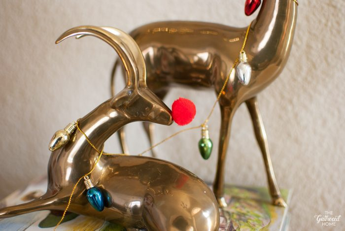 A little red pom pom transforms this brass gazelle figure into Rudolph!