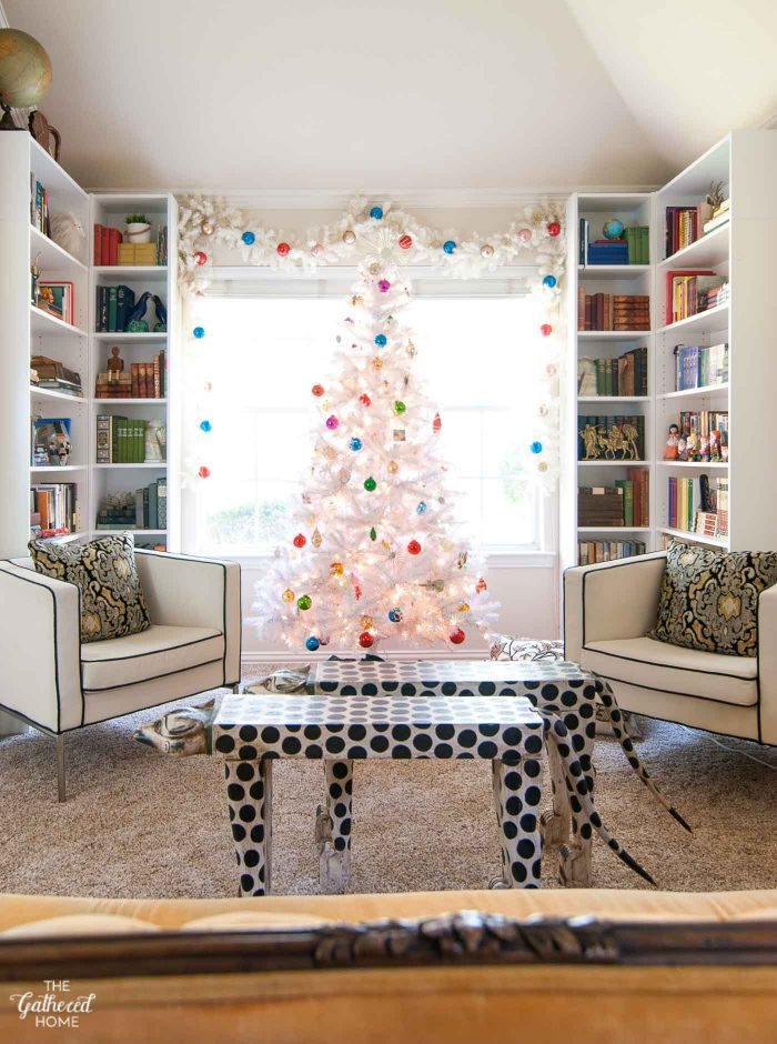 If your Christmas tree needs a little extra height, try framing it with matching garland and decorate the garland as well!