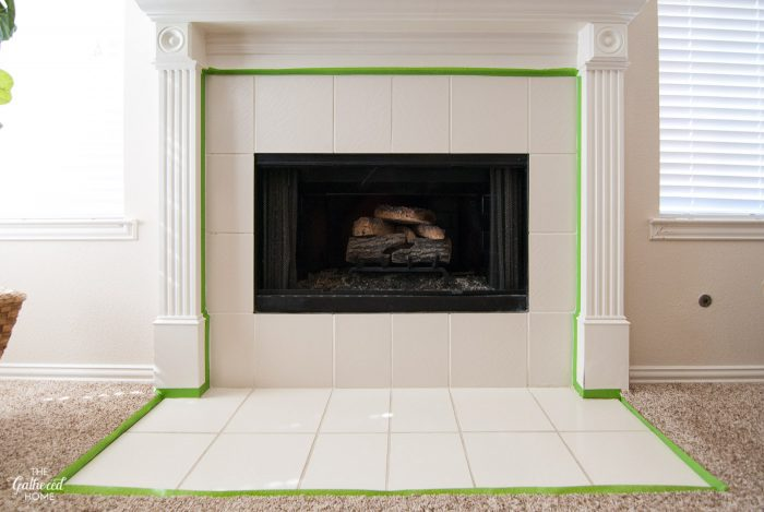 DIY Painted Tile Fireplace Surround: Carefully tape the edges of the trim and flooring around the tile.