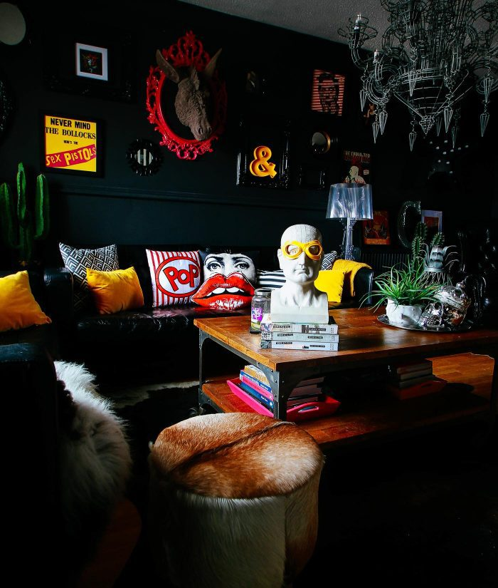 Black walls with bursts of primary-colored accessories in Pati Robin's Rock & Roll Glam Gathered Home