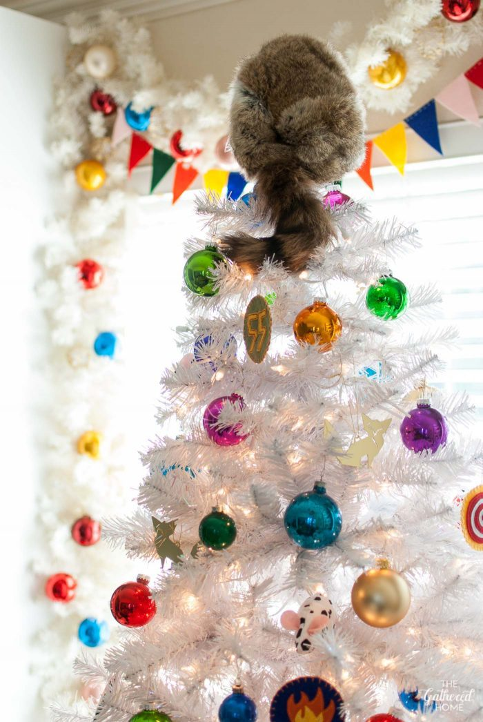 A raccoon cap tree topper calls to mind Moonrise Kingdom in this Wes Anderson-inspired Christmas tree!
